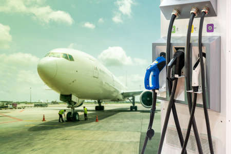 electric aircraft charger station with plug and power cable supply on cargo or airplane parking with blue sky background