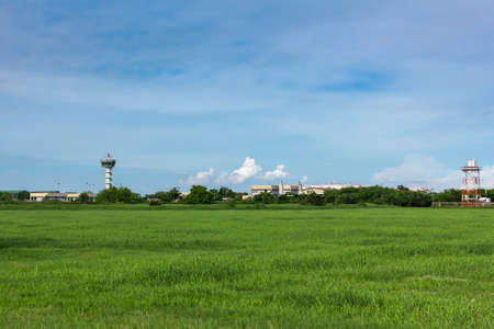 airport control tower for air traffic management with at green field  on  blue cloudy sky background bright day Standard-Bild