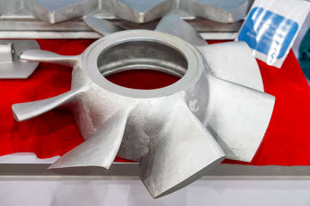iron casting parts vane propeller blade of pump or blower casting by green sand or shell mold process on red table
