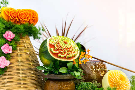 Many colorful and beautiful fruit carved or sculpted such as watermelon cantaloupe pumpkin with copy space