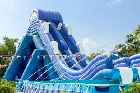 inflatable slide bounce or water sliders at water park Standard-Bild