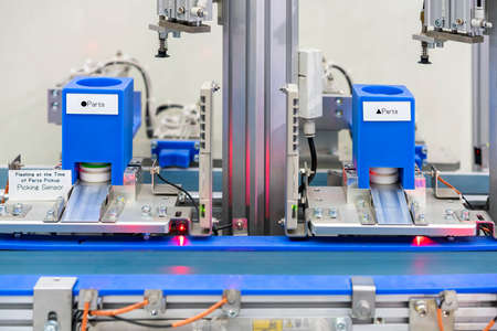 Close up high technology automation production conveyor line with path and sensor for select & automatic suction picking product by pneumatic system for manufacturing in industrial