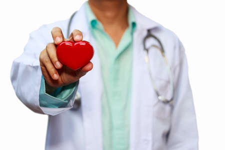 Close up male doctor with red heart isolated on white background Standard-Bild