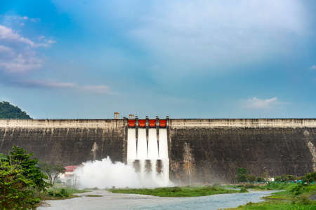 Amazing and beautiful water release at spillway or overflows at big dam with blue sky and cloud (Khun Dan Prakan Chon dam in Nakhon Nayok province Thailand)