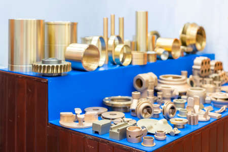 many type and various of industrial metal parts such as vane pump - propeller plug plate flange & other before and after machining gold color or brass manufacturing by green sand or shell mold casting