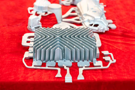 cooling fin or heat sink with gate runner and riser casting parts aluminum alloy for automobile or machine with on red table