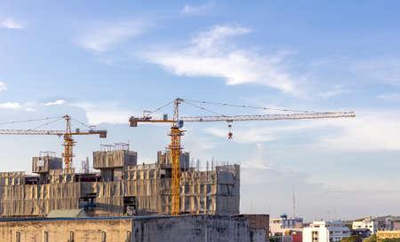 A huge crane building construction site with blue sky