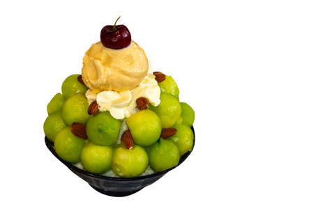 shaved ice or snowflake dessert topped with fruit such as cantaloupe melon cherries and ice cream in bowl (asian or korean japan dessert call bingsu) isolated on white