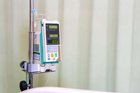 Modern automatic Infusion pump for control infuses fluids medication or nutrients sodium chloride saline solution fluid iv drip with copy space