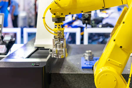 high technology robot grip with automatic clamp or chuck catch and carry engine part transfer to coordinate measurement machine (CMM) for inspection
