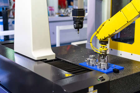 high technology robot grip with automatic clamp or chuck for catch and carry engine part or automobile part (hosing bearing) transfer to coordinate measurement machine (CMM) for inspection