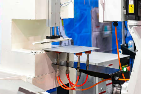 high technology and precision robot arm and automatic vacuum or suction cup for pick & place transportation metal sheet plate or material goods or product of manufacturing process in industrial Stock Photo