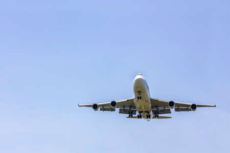 Front side view commercial passenger or cargo airplane flying on blue sky background with copy space Stock fotó