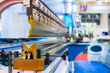 Close up upper move bending blade or punch and fix die of automatic and high precision cnc hydraulic press bending machine for metal sheet forming in industrial