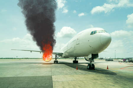 passenger aircraft or cargo airplane parking at terminal gate of international airport on was on fire or burns down at the jet engine in daytime
