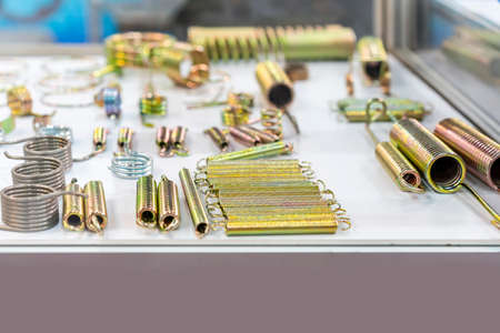 Various and many metal brass and zinc coating coil spring and ring hook tension spring equipment part for different industrial purposes Foto de archivo