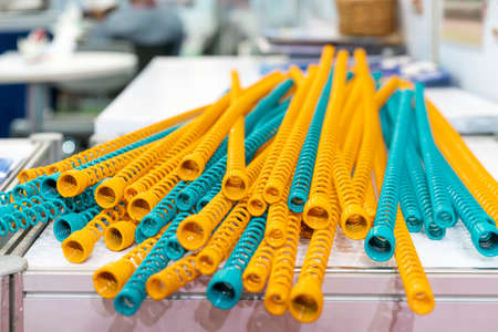 Many Yellow and blue metal coil spring equipment part of appliance machine in manufacturing process or automotive or different industrial purposes