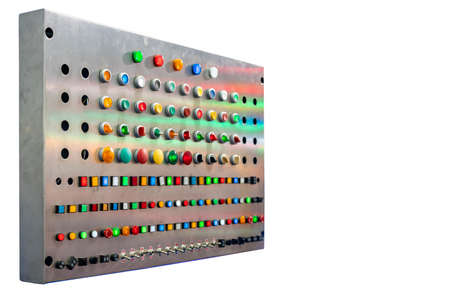 various shape and colorful push button such as dial switch toggle emergency pilot lamp etc of electric control for machine in industrial install on metal panel box isolated with clipping path Foto de archivo
