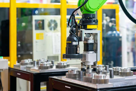 high technology and precision robot grip with camera and automatic clamp or chuck for vision inspection detect sorting and catch metal gear product move or assembly in manufacturing process