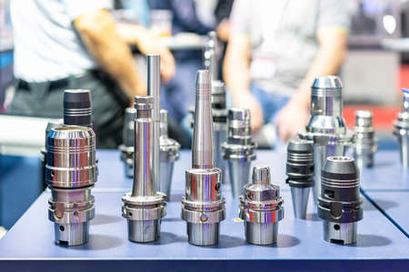 Various many type new and high precision tool holder device for interface cutting tool and spindle of cnc machining center or automatic milling machine on table Foto de archivo