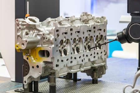 automatic coordinate measurement machine (CMM) during inspection automotive industrial part in quality control manufacturing process Foto de archivo
