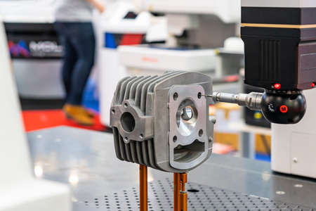 automatic coordinate measurement machine (CMM) during inspection automotive or motorcycle industrial part in quality control manufacturing process