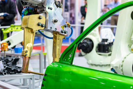 electrode resistance spot welding with robot during simulated position point arc or spark for assembly body frame door automobile part in manufacturing process Foto de archivo