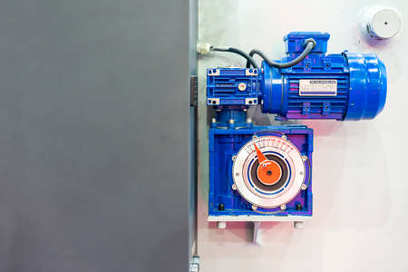 reducer gearbox and electric motor install at manufacturing machine for industrial
