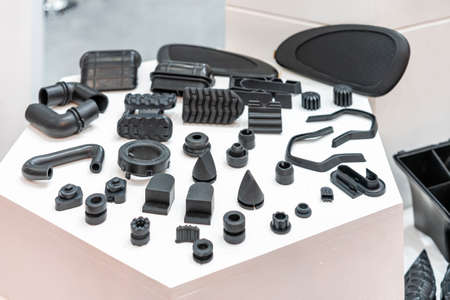 Various compression molded rubber sample parts made from manufacturing process in industrial e.g. plug cover cap pipe tube pedal nozzle connector and automobile parts other Stock fotó