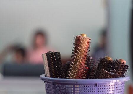 salon background: Close up of combs in basket at salon with blur background.