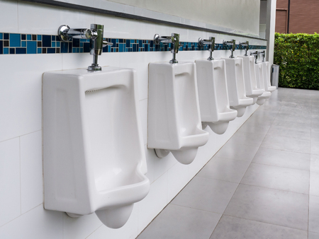 row of outdoor white ceramic urinals men public toilet,Closeup white urinals.