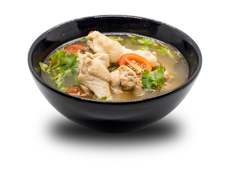 Hot and spicy chicken soup in black bowl on white background, Thai food Tom Yum, Chicken Tom Yum is thai delicious food. Banque d'images