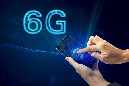 Creative connection background, mobile phone with 6G hologram on the background of the new world era, the concept of 6G network, high-speed mobile Internet, new generation network has a wireless speed limit, mixed media