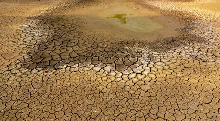 The concept of natural drought of the environment on Earth: dry soil, cracked soil with soil erosion Becomes red that is not agricultural