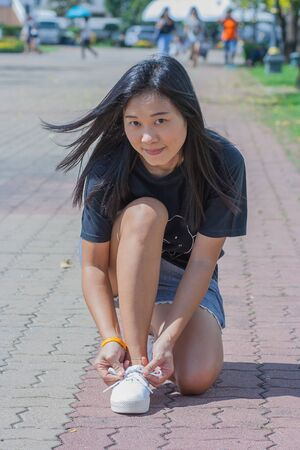 Shoot Asian woman portrait in lifestyle at public park, Bangkok, Thailand. Stock Photo