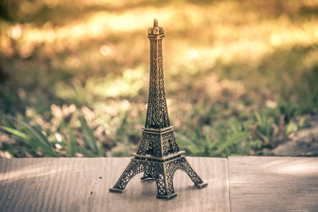 Little model of Eiffel tower with vintage effect.