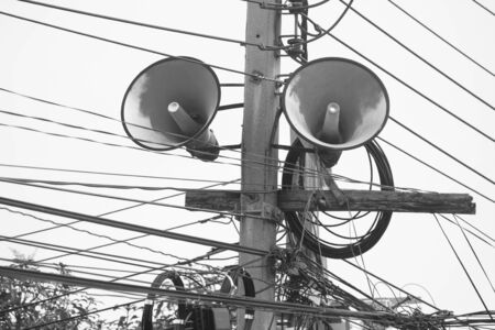 Loudspeaker on electric pole in black and white filter effect. Stok Fotoğraf - 82099949