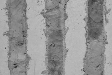 Row of plaster concrete on house's wall. (Black and White filter effect)