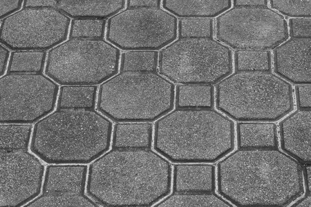 Top view texture of gray block in concrete ground of sidewalk. (Black and White filter effect)