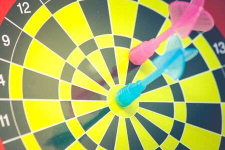 Business Marketing and Strategy Concept : Close up blue dart hit target on dart board in vintage filter effect. (Soft Focus) Stok Fotoğraf