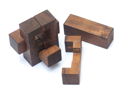 Business Teamwork Concept : Wooden Brain Teaser or Wooden Puzzles on white background.