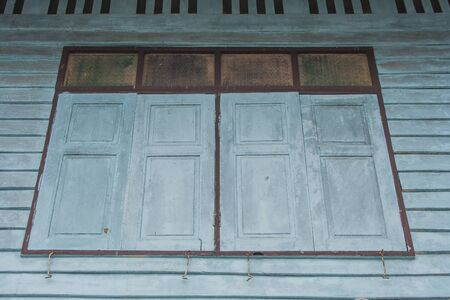 View of wooden window on vintage wall of old wooden house at countryside in vintage style. Stok Fotoğraf