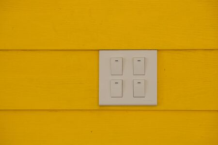 Close up white electricity switch or light switchon yellow color wall background. (Soft Focus) Stok Fotoğraf - 83080605