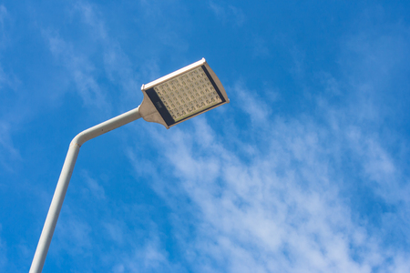 Uprisen view of street lamp on walkway with blue sky.
