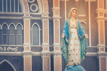 The Blessed Virgin Mary statue standing in front of The Roman Catholic Diocese that is public place in Chanthaburi Province, Thailand.
