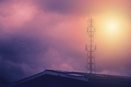 Television antenna with sunlight background in cloudy day. Stok Fotoğraf