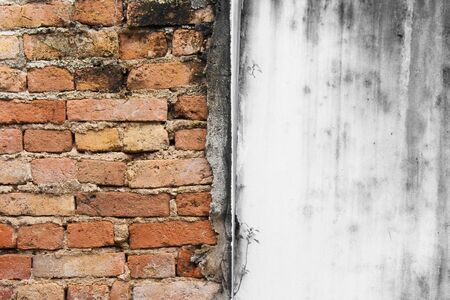 Abstract image of haft red brick wall texture grunge background with black and white background.