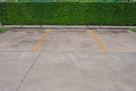 Empty space in car parking lot at outdoor park with green bush background. Stok Fotoğraf - 83701832