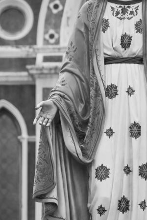 Hand of The Blessed Virgin Mary statue standing in front of The Roman Catholic Diocese that is public place at Chanthaburi Province, Thailand.