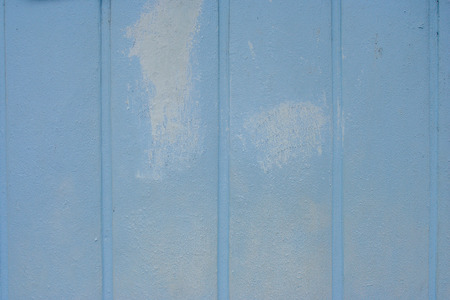 Paint on wall peeling seamless texture with pattern of rustic blue grunge material.